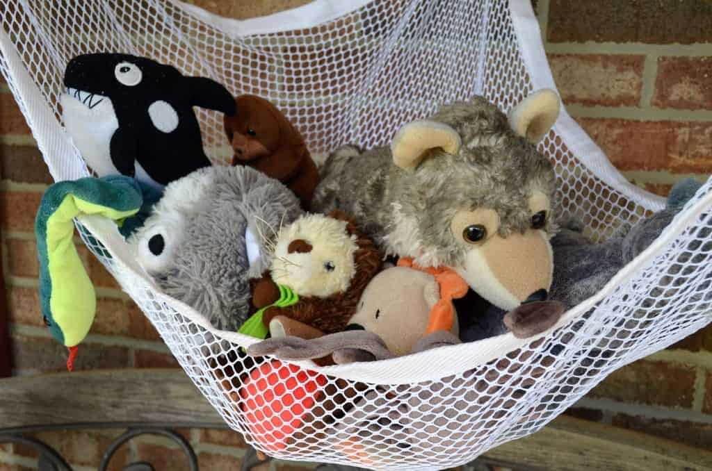 image of net filled with a variety of stuffed animals