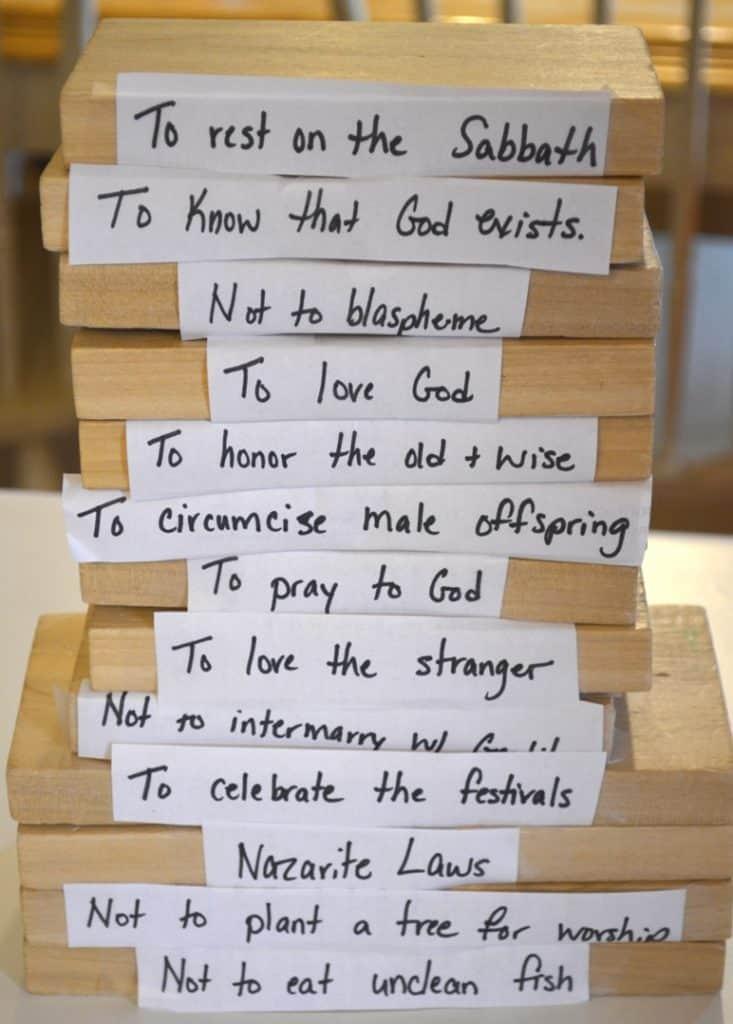 13 wooden blocks with 13 Jewish laws written, one law per block