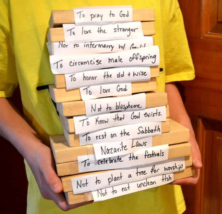 Child holding the 13 blocks in a stack