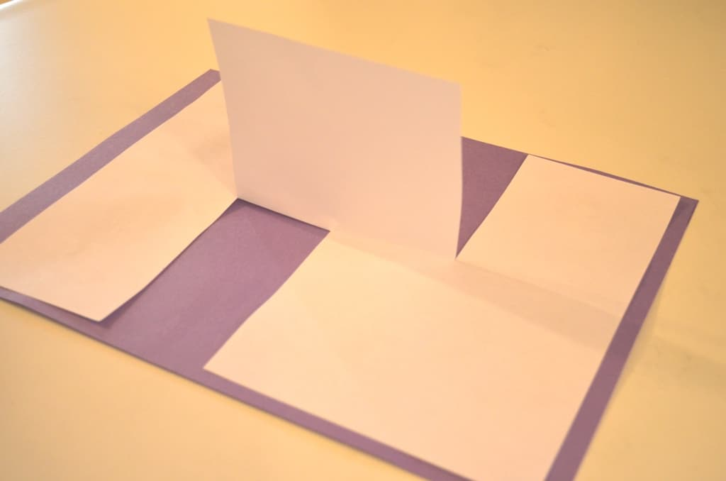 the finished illusion page glued to a purple sheet of construction paper