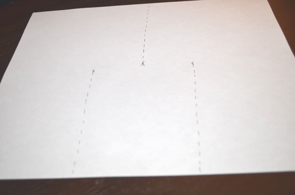 sheet of typing paper with 3 dashed lines showing where to cut the paper